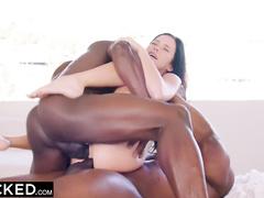 Petite brunette Megan Rain is sucking black cock and feeling second dick in her deep cunt