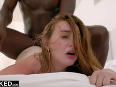 Redhead young chick hotly kisses and passionately fucks her black boyfriend